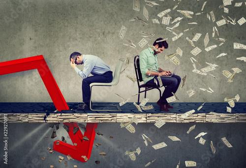 Stressed businessman looking down at falling down arrow sitting next to a succes Obraz na płótnie