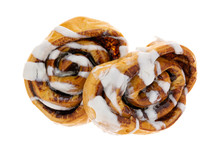 Overhead View Of  Two Warm Freshly Baked Cinnamon Rolls Isolated On A White Background.