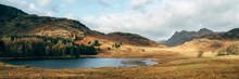Blea Tarn With Langdale Pike Beyond. Cumbria, UK.