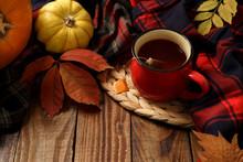 Hot Cup Of Tea And Pumpkins