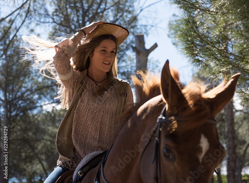 Young woman riding horse on nature