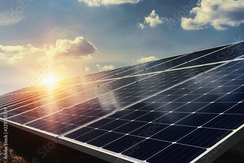 Fotografie, Tablou solar panel with sunlight and blue sky background