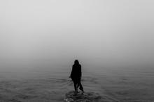 Woman Walks On Water In Fog