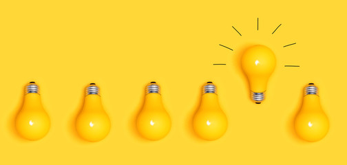 One outstanding idea concept with yellow light bulbs