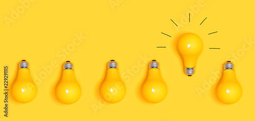 Photo  One outstanding idea concept with yellow light bulbs