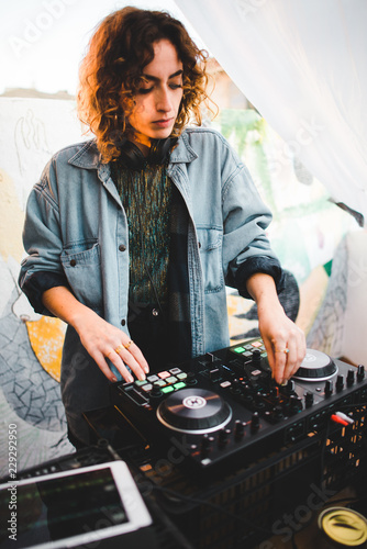 Female DJ at a rave party