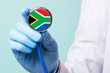 canvas print picture - Medicine in South Africa is free and paid. Expensive medical insurance. Treatment of disease at the highest level Doctor holding a stethoscope in his hand