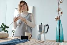 Thoughtful Woman Knitting