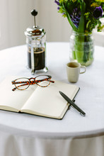 Blank Page Of A Notebook Or Journal With Coffee.