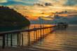 wooden pier at sunset on Koh Kood in Thailand.