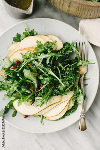 Close up view of pear and arugula salad