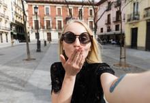 Young Model Sending Air Kiss At Camera