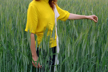 Crop Portrait Of A Woman At Wheat Field