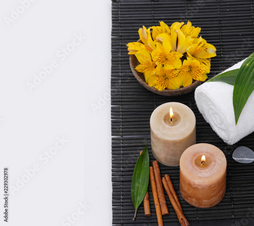Keuken foto achterwand Spa Spa setting with candle, towel ,orchidin bowl, cinnamon on mat
