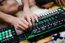 Male DJ Playing Electronic Music With A Mixing Table