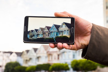 Smartphone Screen Displaying Row Of Homes On A San Francisco Hil