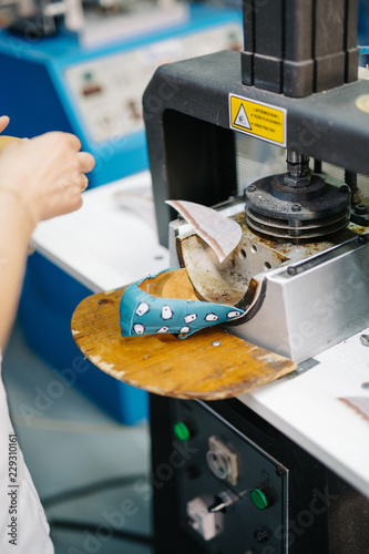 Person using press for shoes making