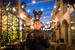 Christmas and holiday concept - Happy man in Christmas deer costume with sparkler