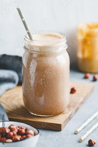 Stampa su Tela Nut butter chocolate protein shake in a glass jar