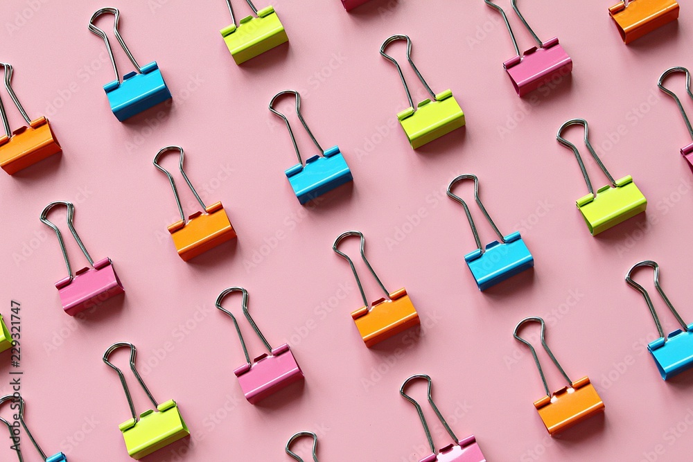 Fototapety, obrazy: Business, office supplies, teamwork, corporation, collaboration or unity concept : Lines of multi colored binder clips on pink background