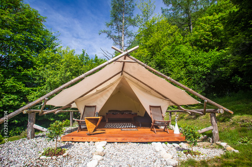 Glamping tent exterior in Adrenaline Check eco camp in Slovenia. Fototapeta