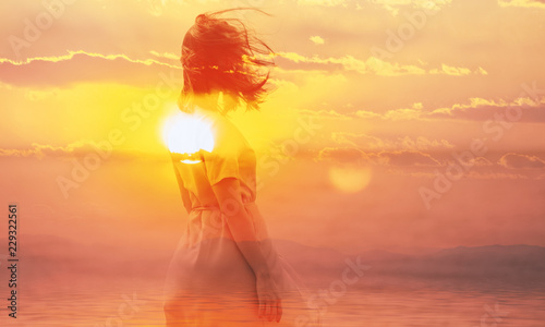Obraz Double exposure of young woman and sunset sky. - fototapety do salonu