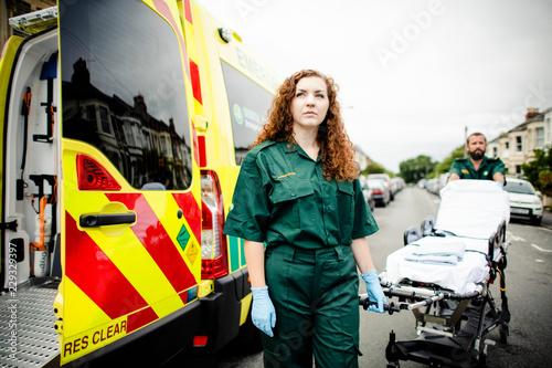 Photo Paramedics rolling the ambulance stretcher