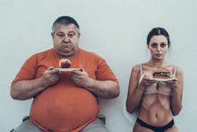 Fat Man And Anorexic Girl With...