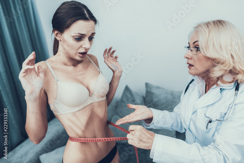 Anorexic Young Girl with Doctor in White Coat. Wallpaper Mural