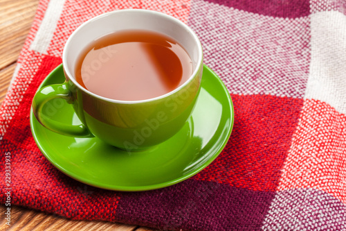 Foto op Aluminium Thee Cup of hot tea dressed in knitted warm winter scarf