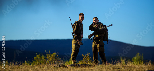 Foto auf AluDibond Jagd Guys hunting nature environment. Hunting season. Masculine hobby activity. Men bearded hunters with rifle nature background. Experience and practice lends success hunting. How turn hunting into hobby