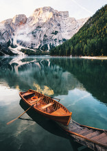 Boats And Slip Construction In Braies Lake With Crystal Water In Background Of Seekofel Mountain In Dolomites In Morning, Italy Pragser Wildsee