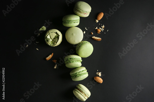 Wallpaper Mural Fresh tasty macaroons with almond nuts on dark background