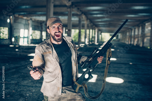 Fotografie, Obraz  Courageous and fearless bearded man is standing and screaming