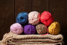 Balls Of Woolen Yarn For Knitting On Wooden Background