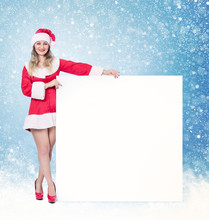 Santa Girl Holding Big White S...