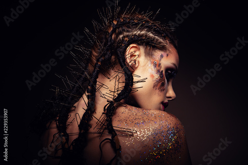 Spoed Foto op Canvas Beauty Fashion model with bright makeup and colorful glitter and sparkles on her face and body