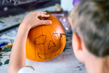 Blond Boy Carving Pumpkin Jack...