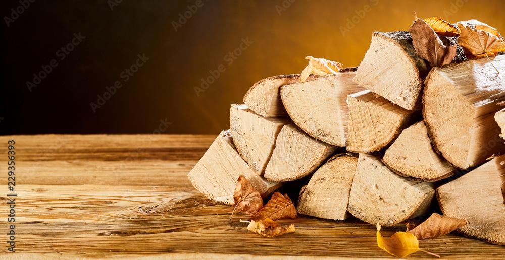 Fototapeta Stockpile of timber wood logs sitting on table