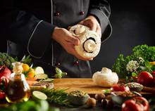 Chef Holding Large Fresh Portobello Mushrooms