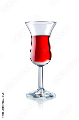 a glass of red liqueur