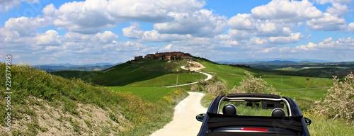 Italy: Small car in tuscan hills. Wallpaper Mural