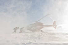 Heliski Helicopter Takes Off In Snow Powder Freeride Landed On Mountain