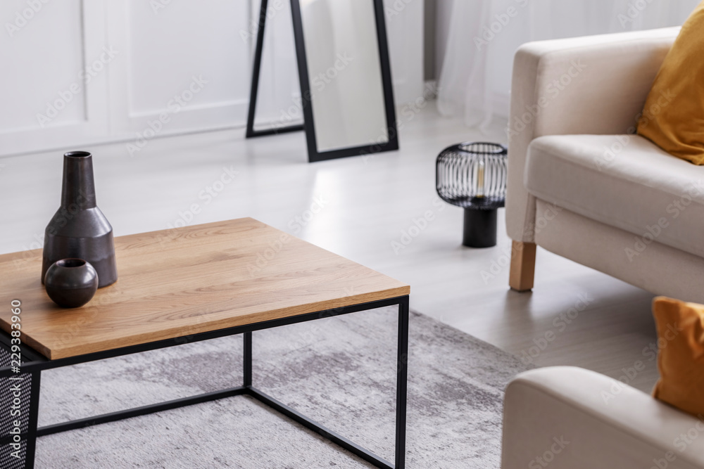 Fototapety, obrazy: Ceramic vases on simple wooden coffee table in elegant living room, real photo