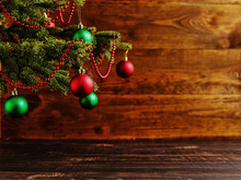 Christmas Tree, Dressed Up Balls, Stands On A Wooden Table. Copy Space.