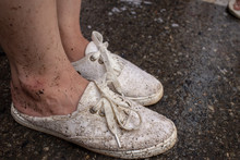 Girl With Dirty White Shoes With Muddy Stain On Every Shoes And Foot