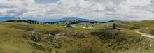 Panorama View Of The Huts On Velika Planina, Kamnik Savinja Alps, Slovenia. High Alpine Meadows And Pastures Of Famous Velika Planina.