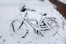 Abandoned Bike Or Bicycle With Snow Cover In Winter