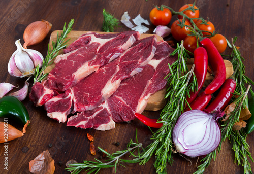 Raw beef meat with rosemary