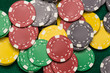 Casino chips on green table